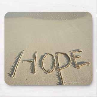 The word 'Hope' sand written on the beach with Mouse Pad