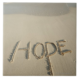 The word 'Hope' sand written on the beach with Tile