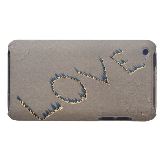 The word Love spelled out in the sand. iPod Touch Cover