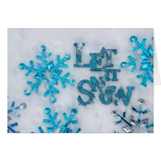 The words 'Let it snow' and scattered blue Card