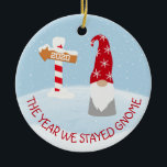 """The Year we Stayed Home 2020 Gnome Christmas Ceramic Ornament<br><div class=""""desc"""">This design may be personalized in the area provided by changing the photo and/or text. Or it can be customized by choosing the click to customize further option and delete or change the color of the background, add text, change the text color or style, or delete the text for an...</div>"""