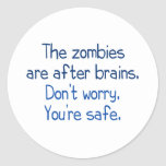 The zombies are after brains classic round sticker