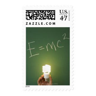 Theory of relativity on blackboard postage