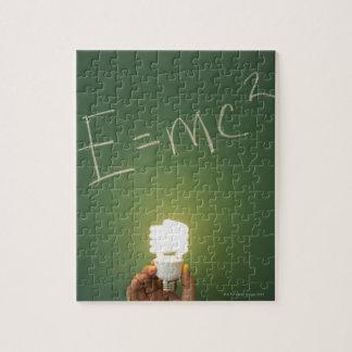 Theory of relativity on blackboard jigsaw puzzle