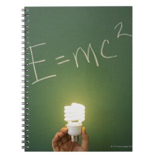 Theory of relativity on blackboard spiral notebook