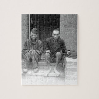 These two staring, emaciated men are_War Image Jigsaw Puzzle