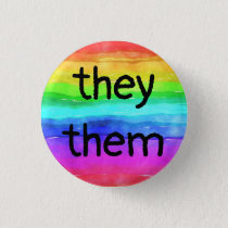 they/them pronouns on a rainbow button