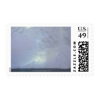 Thin backlit and almost transluscent ice wall of stamps