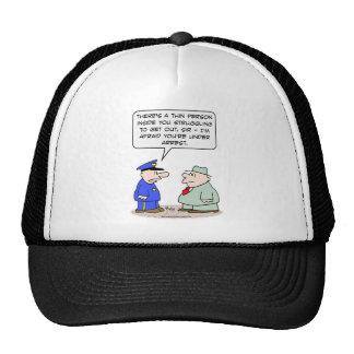 thin person struggling under arrest trucker hat