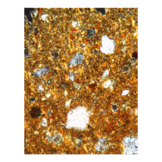 Thin section of a brick under the microscope letterhead