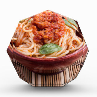 Thin spaghetti with tomato relish and basil leaves award