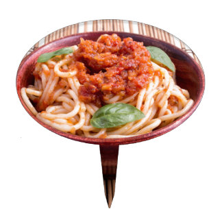 Thin spaghetti with tomato relish and basil leaves cake topper