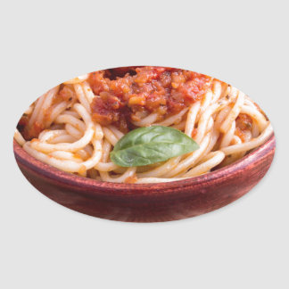 Thin spaghetti with tomato relish and basil leaves oval sticker