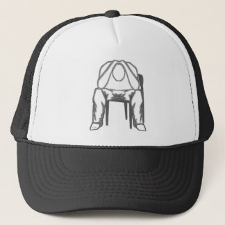 Thinking Man sitting in chair holding his head. Trucker Hat