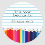 """This Book Belongs to Pencils Bookplate<br><div class=""""desc"""">Notebook paper look, personalized bookplate label stickers- Lined school paper background. Reads &#39;This Book Belongs to&#39; in black lettering. Name in handwritten look lettering underneath. Bordered at bottom with photo of row of bright, colored art pencils. Click Customize option to change text colors, size, and font styles. Cute custom bookplates...</div>"""