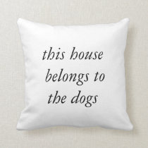 """This house belongs to the dogs"" cushion"