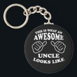 """This Is What An Awesome Uncle Looks Like Keychain<br><div class=""""desc"""">A fun style retro design featuring two hands pointing to the special guy wearing the shirt or item letting everyone know he's an awesome uncle.</div>"""