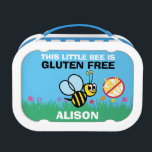 """This Little Bee is Gluten Free Lunch Box<br><div class=""""desc"""">This little bee is gluten free lunch box. Yellow and black bumble bee with &quot;no gluten&quot; symbol on a blue sky and green grass with flowers background. Remind others at meal times of dietary restrictions. Great for kids with celiac for school daycare or use as a safe snack box. Personalize...</div>"""