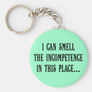 This place reeks of incompetence (2) basic round button keychain