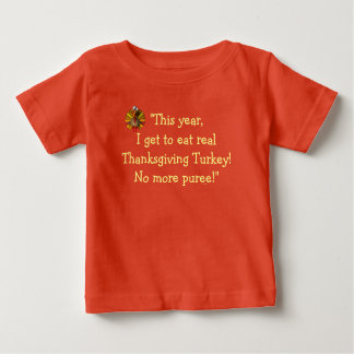 """This year, I Get to Eat Real Turkey."" [b] Baby T-Shirt"
