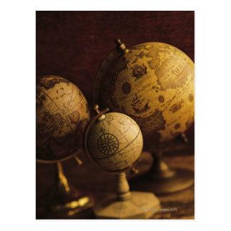 Three antique globes postcard
