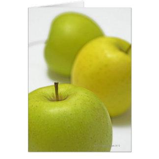 Three apples, close-up card