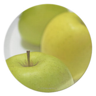 Three apples, close-up dinner plate