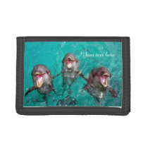 Three Beautiful dolphins playing in the ocean Trifold Wallet