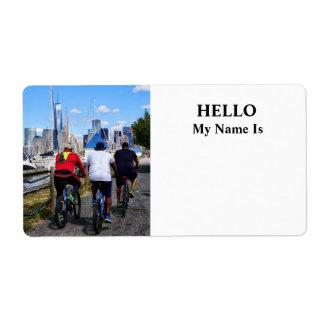 Three Bicyclists By Liberty Landing Marina Label