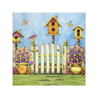 Three Birdhouses in a Garden Canvas Print