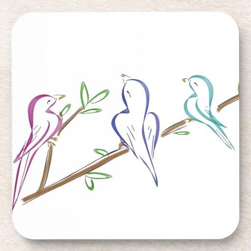 Three birds sitting on a branch beverage coaster