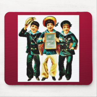 Three boys and one boys holds the christmas wishes mousepad