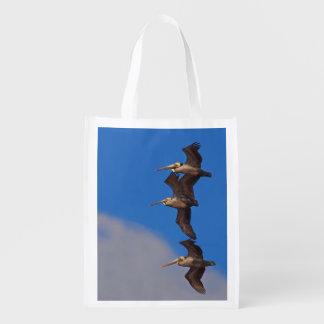 Three Brown Pelicans in Flight Foldable Bag