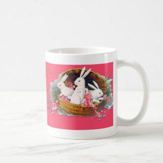 Three bunnies in a basket mug
