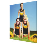 Three cheerleaders forming human pyramid on gallery wrap canvas