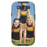 Three cheerleaders forming human pyramid on galaxy SIII covers