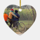 Three children on a cycle at the side of the road christmas tree ornament