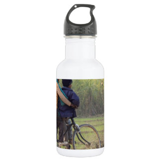 Three children on a cycle at the side of the road stainless steel water bottle
