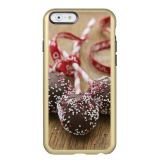 Three chocolate lollipops incipio feather shine iPhone 6 case