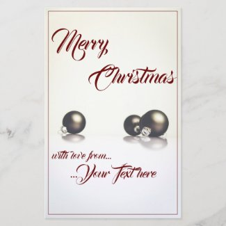 Three christmas balls in front of light background