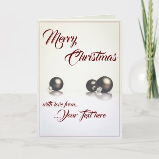 Three christmas balls in front of light background card