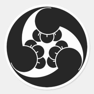 Three counterclockwise clove swirls classic round sticker