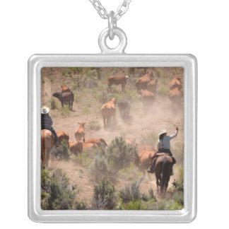 Three cowboys and cowgirls driving cattle square pendant necklace