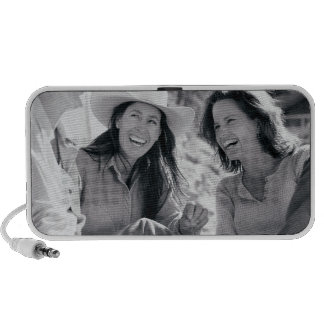 Three cowgirls laughing together laptop speakers