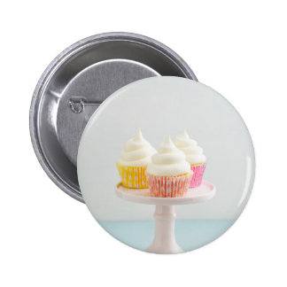 Three cupcakes on cake stand pinback button