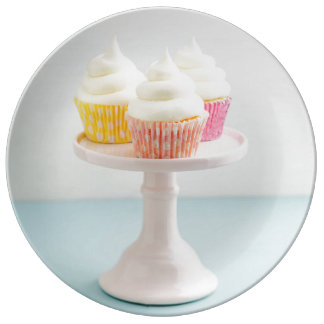 Three cupcakes on cake stand plate