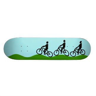 Three cyclists skateboard deck