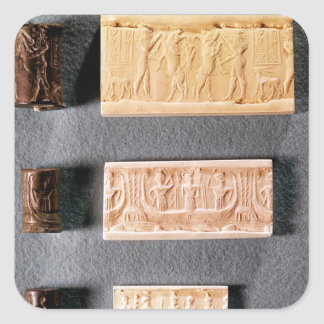 Three cylinder seals with impressions,