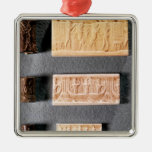 Three cylinder seals with impressions, metal ornament