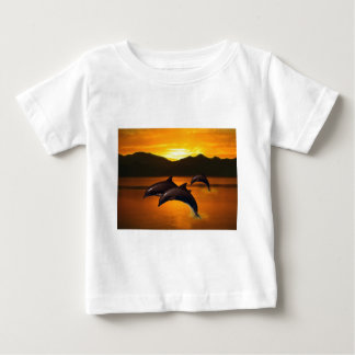 Three dolphins at sunset baby T-Shirt